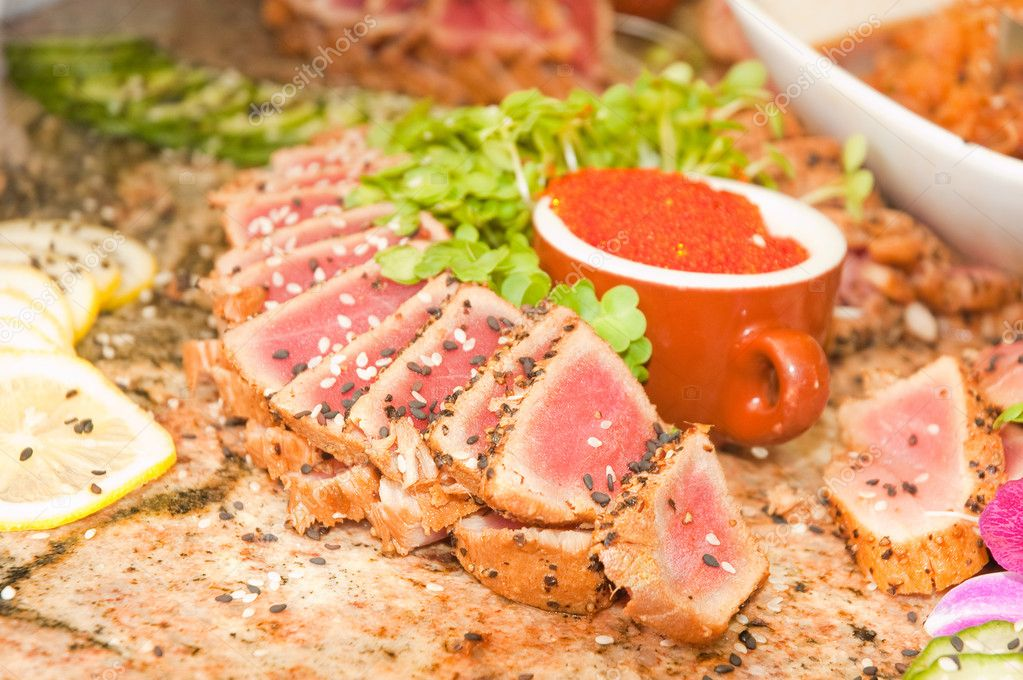 Seared ahi tuna with tobiko roe on a granite table  Stock Photo #11113782