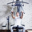 Fitness - powerful muscular man doing weightlifting in gym — Stock Photo