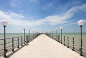 Pier on the coast of the Sea — Stock Photo