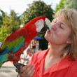 Woman with red macaw — Stock Photo