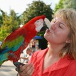 Woman with red macaw — Stock Photo #11896110