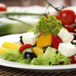 Tasty salad in white dish — Stock Photo