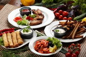 Peaces of meat with vegetables — Stock Photo