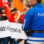 European Police Blue Uniform Back One Smile — Stock Photo