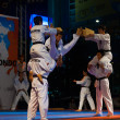 Taekwondo Double Kick Mid-Air Breaking Boards — Stock Photo