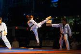 Korean Taekwondo Girl Jump Kicking Breaking Board — Stock Photo