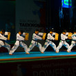 Stock Photo: Taekwondo Kicking Breaking Row Wooden Boards
