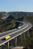 Aerial view of motorway with yellow and white trucks — Stock Photo