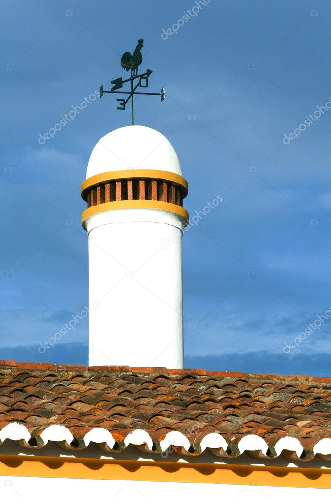 Typical chimney with weathervane from Alentejo in south of Portugal  Stock Photo #11606724
