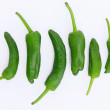 Green peppers on white background — Stock Photo