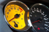 Sportscar yellow speed gauge — Stock Photo