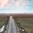 Wadden sea road to the island Mando, Denmark - Stock Photo