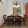Dining room with orange wall — Stock Photo