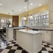 Kitchen with black and white flooring - Stock Photo