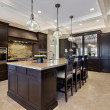 Luxury kitchen with dark cabinetry - Stock Photo