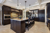 Luxury kitchen with dark cabinetry — Stock Photo