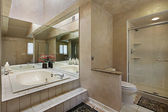 Master bath with mirrored tub — Stock Photo