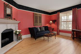 Living room with red walls — Stock Photo