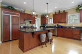 Kitchen with cherrywood cabinetry — Stock Photo