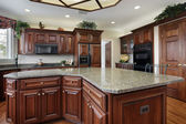 Kitchen with large center island — Stockfoto