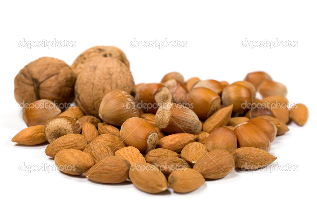 Filberts , almonds and walnuts on a white background  Stock Photo #10827706