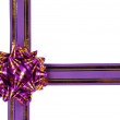 Purple ribbon and a gift bow — Stock Photo