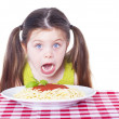 Beautiful girl eating pasta — Stock Photo