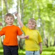 Children playing and flying a paper airplane — Stock Photo