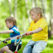 Stock Photo: Little children riding their bikes
