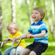 Little children riding their bikes — Stock Photo #10881075