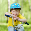 Nice kid weared in helmet on bicycle — Foto Stock