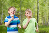 Young kids eating a tasty ice cream outdoor — Stock Photo