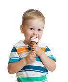 Happy kid boy eating ice cream in studio isolated — Stock Photo