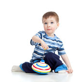 Cute little child is playing with toys while sitting on floor, i — Stock Photo