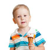 Happy child eating ice-cream in studio isolated — Stock Photo