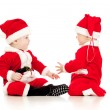 Two funny small kids in Santa Claus clothes isolated on white ba — Stock Photo