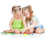 Two kids sisters paly together, isolated on white background — Stock Photo
