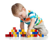 Kid playing toy blocks isolated on white background — Stock Photo