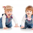 Funny kids girls crawling on floor — Stock Photo