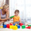 Cute mother and kid boy playing together indoor — Stock Photo #11802412