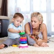 Stock Photo: Cute mother and kid boy playing together indoor