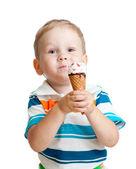 Happy child boy eating ice cream in studio isolated — Stock Photo