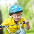 Portrait of a cute kid on bicycle — Stock Photo