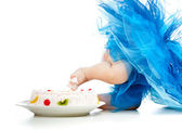 Funny baby foot in cake — Stock Photo