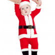 First steps of child dressed as Santa claus — Stock Photo #12084642