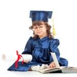 niña chica en ropa de académico con libro — Foto de Stock