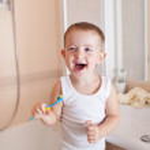 Boy brushing teeth in bathroom — Stock Photo