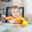 Cute little boy eating healthy food at kitchen — Stock Photo