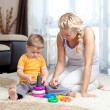 Cute mother and kid boy playing together indoor — Stock Photo