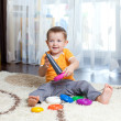 Child playing with toy at home. — Stock Photo #12111575